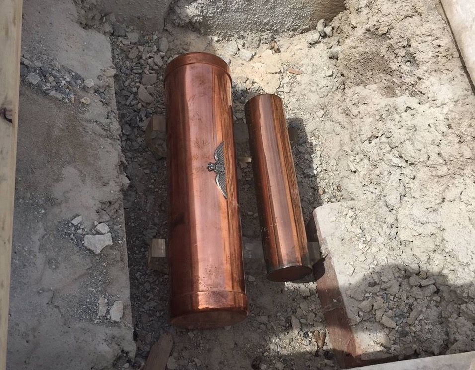 Two copper canisters interred in the AFC Memorial