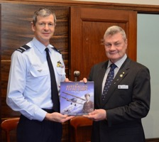 Carl Schiller, National President AFA presenting a copy of the book to AIRCDRE Glen Braz