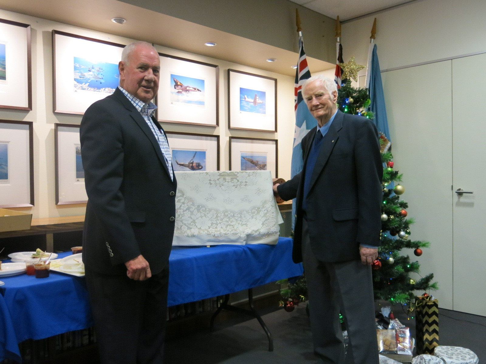 AIR CDRE Ted Bushell (RETD) presents AFA Victoria President Max McGregor with the second Norman Clifford painting of Point Cook.